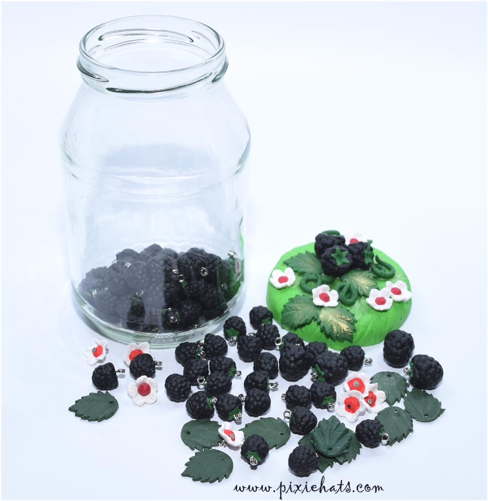 Polymer clay blackberry charms in decorated glass jar