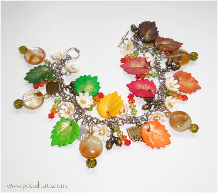 Handmade polymer clay bracelet filled with autumn leaves