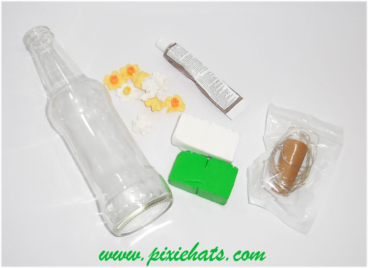 Materials needed to mke a daffodil grass glass bottle light