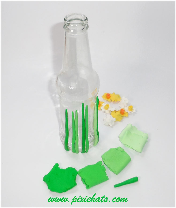 Blend the green and white polymer clay to make grass for the bottle
