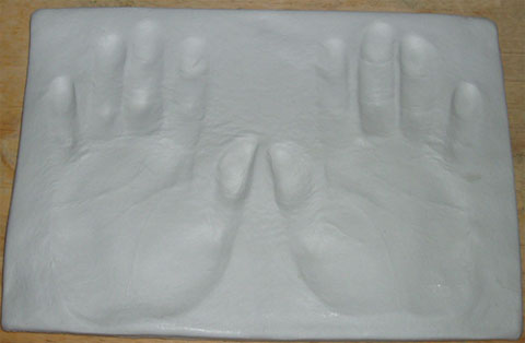 Making hand prints in clay