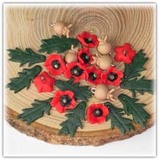 Poppy flower beads, seed head and leaf charms