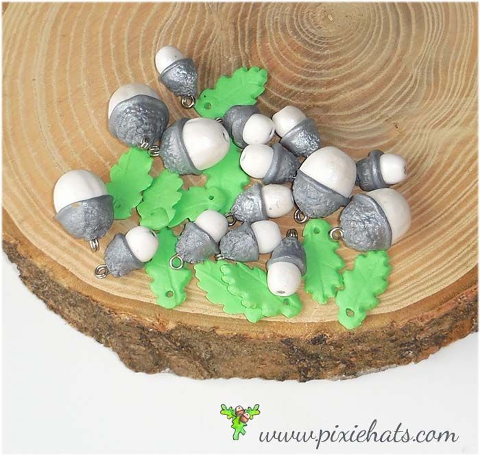 Silver coloured acorn beads and oak leaf charms