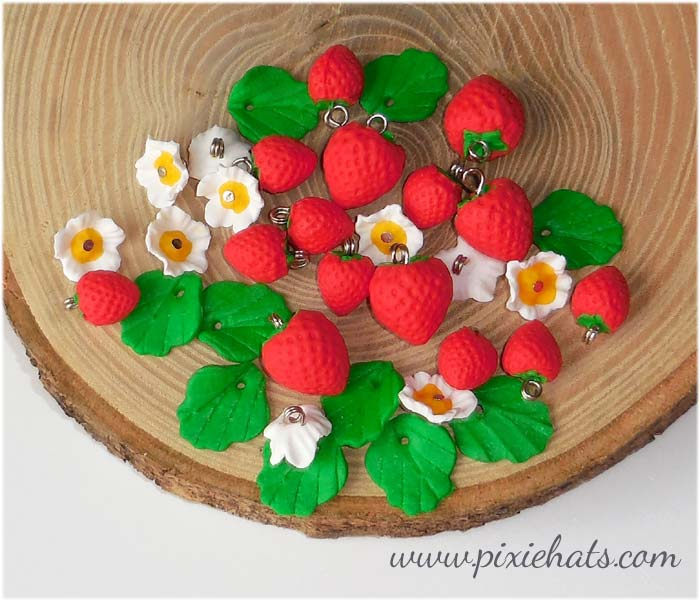 Strawberry beads, flower blossom and leaf charms